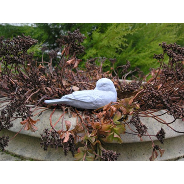 Preening Bird statue - natural stone
